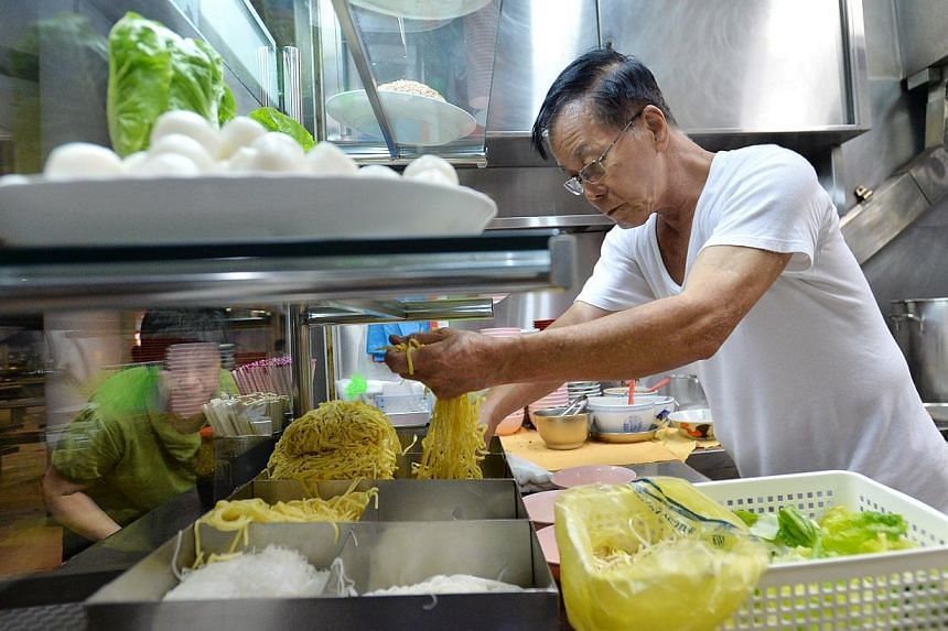 All the action happens before 11am at this stall (above), which sells fishball noodles and mushroom minced pork noodles -- PHOTO: LIM YAOHUI FOR THE STRAITS TIMES