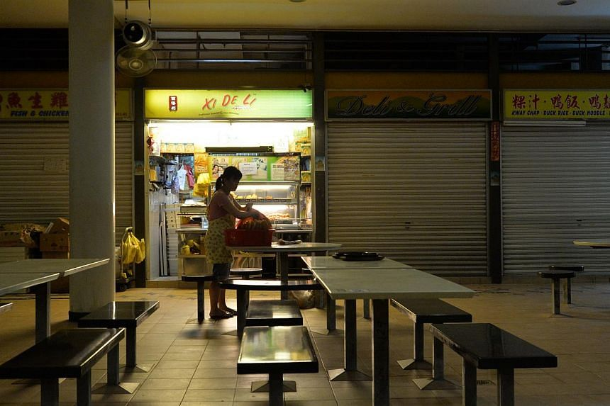 Stalls in Tiong Bahru Market And Food Centre which open early include Xi De Li (above), Teck Seng Soya Bean Drinks and Yuan Ji Fishball Noodle. -- PHOTO: LIM YAOHUI FOR THE STRAITS TIMES