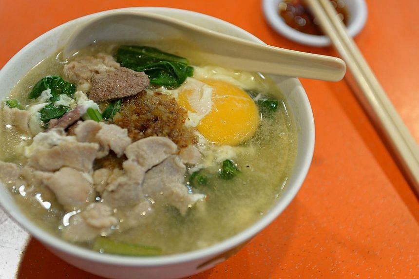 The stall's most popular dish is Koka instant noodles cooked in a pork broth (above). -- PHOTO: NG SOR LUAN