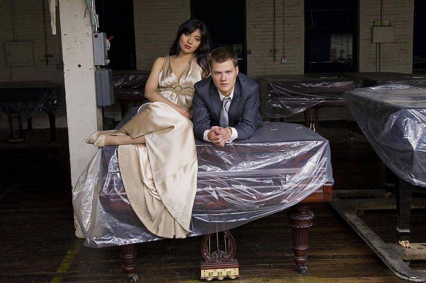 The Anderson & Roe Piano Duo made up of Greg Anderson and Elizabeth Joy Roe will be playing for one night only at the Esplanade on June 13. -- PHOTO: KEN SCHLES