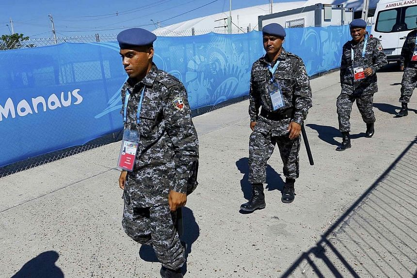 Brazilian police officers arrive at the stadium ahead of the World Cup soccer match between England and Italy in Manaus June 14, 2014. Police in the Brazilian state of Mato Grosso are investigating the alleged attempted rape of an American woman