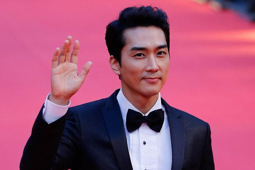South Korean actor Song Seung Heon arrives on the red carpet of Shanghai International Film Festival openning ceremony in Shanghai on June 14, 2014. Shanghai last night kicked off its annual film festival, a nine-day event with a heavy emphasis on Ch