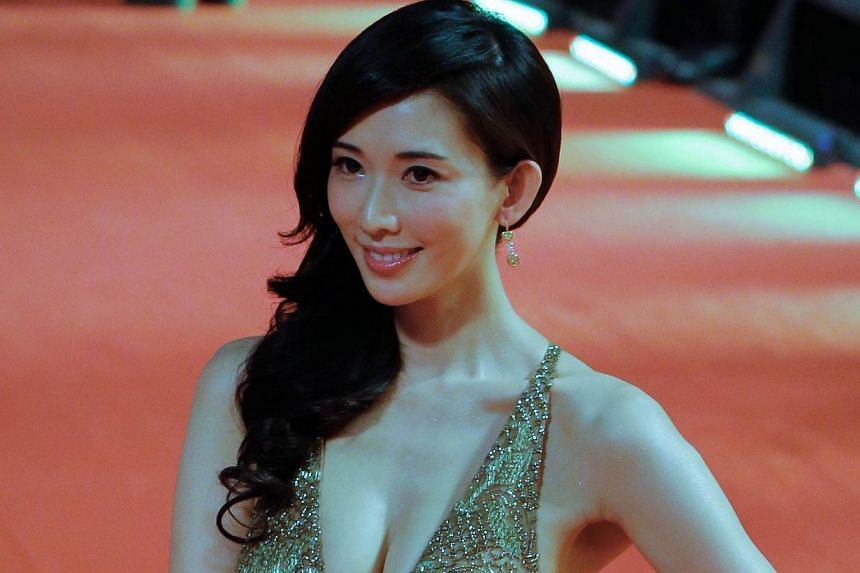 Taiwanese actress Lin Chi-ling arrives at the red carpet of Shanghai International Film Festival opening ceremony in Shanghai on June 14, 2014.Shanghai last night kicked off its annual film festival, a nine-day event with a heavy emphasis on Ch