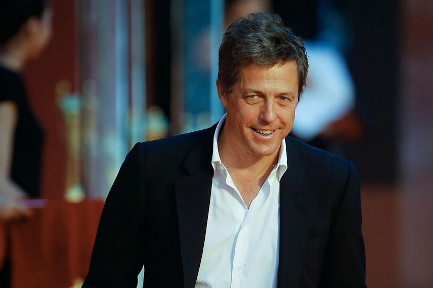 English actor Hugh Grant arrives at the red carpet of the Shanghai International Film Festival opening ceremony in Shanghai on June 14, 2014.Shanghai last night kicked off its annual film festival, a nine-day event with a heavy emphasis on Chin