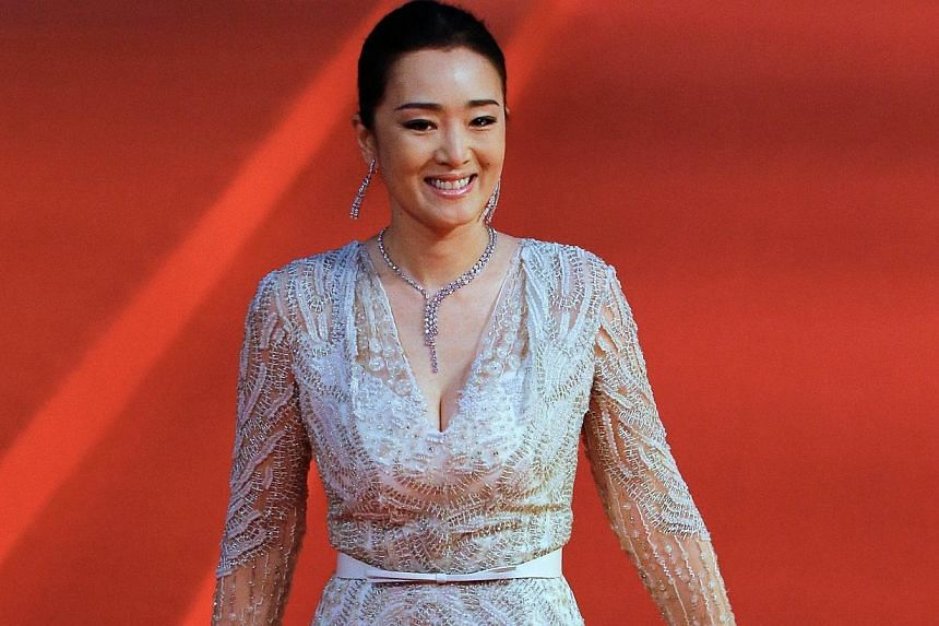 Chinese actress Gong Li arrives at the red carpet of the Shanghai International Film Festival opening ceremony in Shanghai on June 14, 2014.Shanghai last night kicked off its annual film festival, a nine-day event with a heavy emphasis on Chine