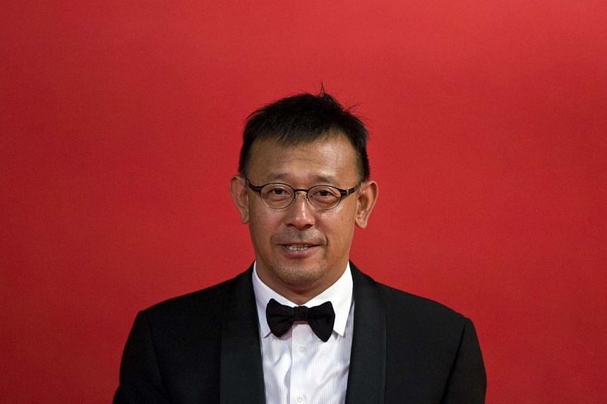 Actor and director Jiang Wen arrives at the 17th Shanghai International Film Festival on June 14, 2014.Shanghai last night kicked off its annual film festival, a nine-day event with a heavy emphasis on Chinese cinema and a sprinkling of Hollywo