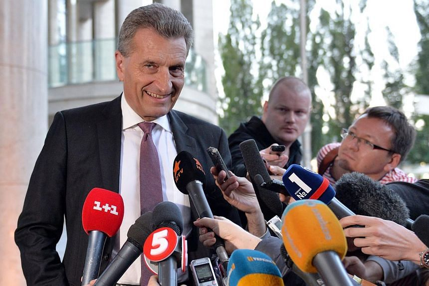 EU Energy Commissioner Guenther Oettinger speaks to the media prior to a round of talks with Russian Gazprom company and Ukraine's energy minister, in Kiev on June 14, 2014. -- PHOTO: AFP