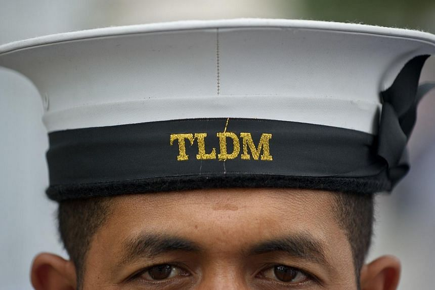 A Royal Malaysian Navy personnel stands to attention before the arrival of Chief Of Royal Australian Navy Vice Admiral Ray Griggs at the Defence Ministry in Kuala Lumpur on May 12, 2014.Malaysia's navy has fought off a pirate attack on a tanker