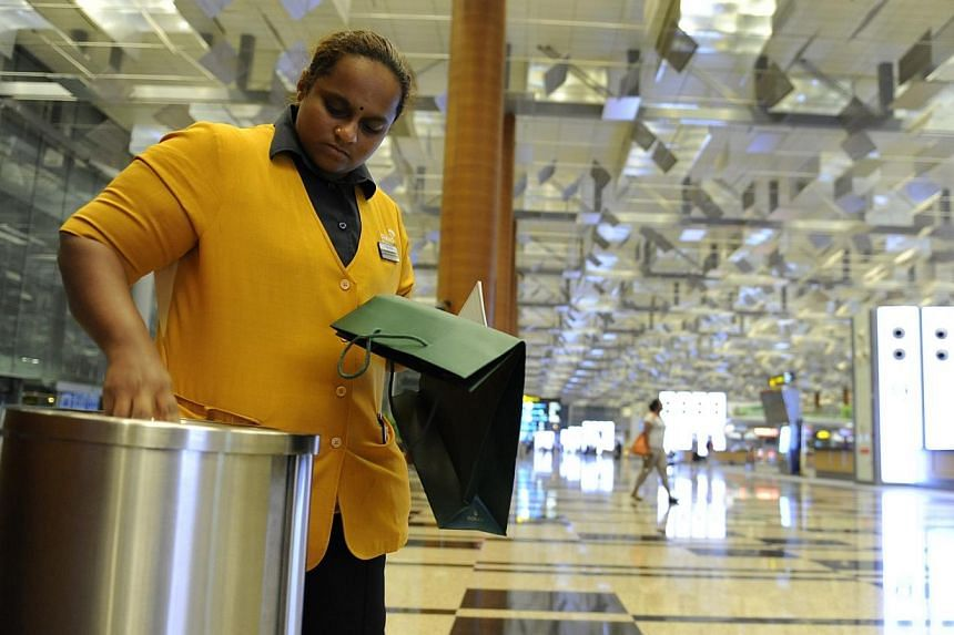 Madam Pusparani Mohan resuming work as a cleaner at Changi Terminal 3. When Malaysian cleaner Chandra Mogan Panjanathan, 34, was killed in a freak accident at Changi Airport two years ago, Singaporeans dug into their pockets to help his widow an