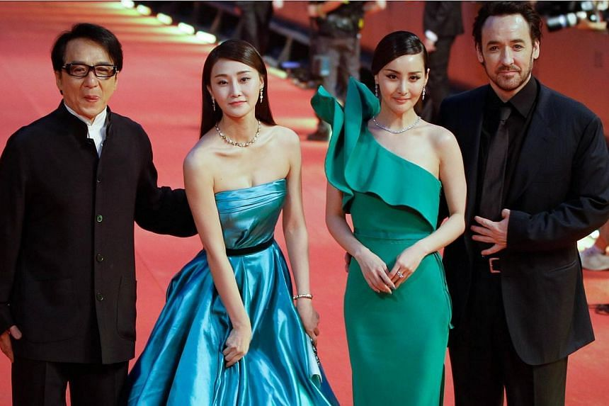 Hong Kong action star Jackie Chan (left) and US actor John Cusack (right) arrive at the red carpet of Shanghai International Film Festival opening ceremony in Shanghai on June 14, 2014.Shanghai last night kicked off its annual film festival, a