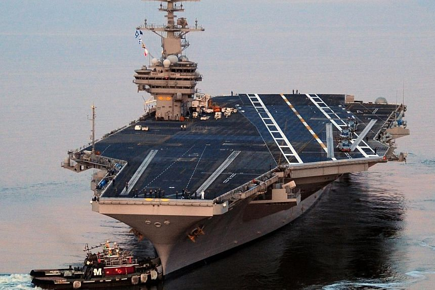 This US Navy photo shows the Nimitz-class aircraft carrier USS George H.W. Bush as it departs Naval Station Norfolk for its maiden deployment May 11, 2011. US Defence Secretary Chuck Hagel ordered an aircraft carrier moved into the Gulf on Satur