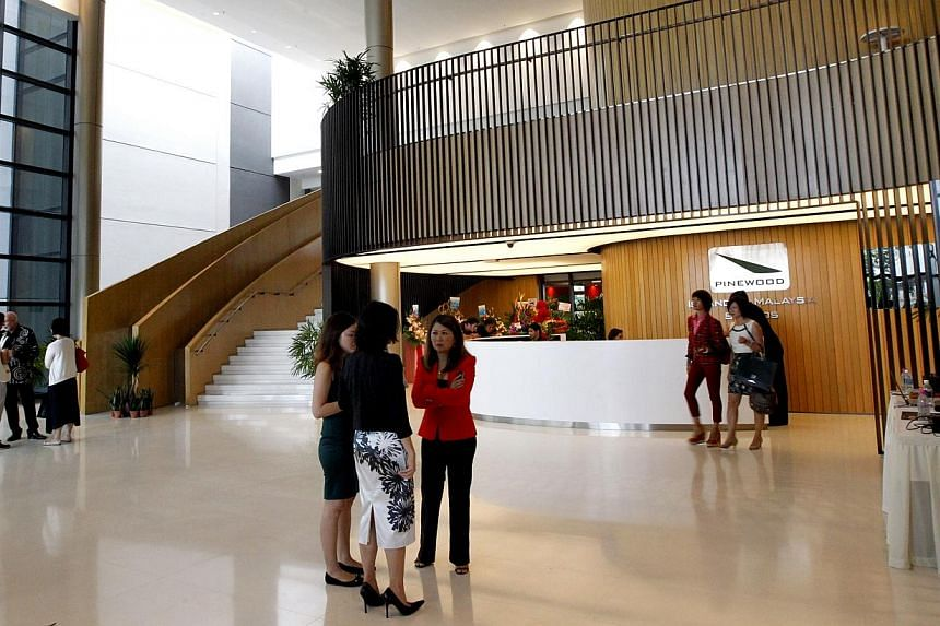 The reception (above) at Pinewood Iskandar Malaysia Studios and the green room at the television studios, where on-air guests wait before being called up.-- ST PHOTO: CHEW SENG KIM