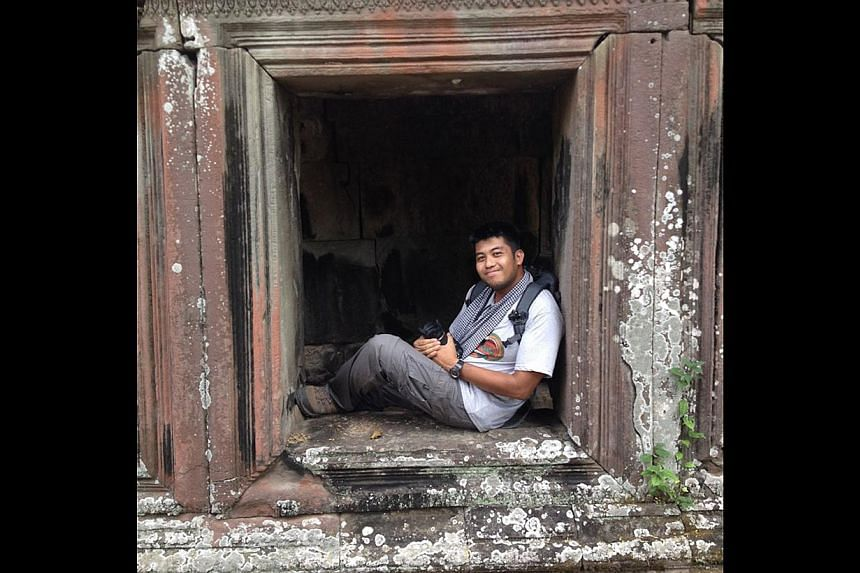 Mr Tan (above) at Cambodia's Angkor Wat. While volunteering at an excavation project at the 12th century site in 2010, he stumbled upon markings, including this painting (below). The never-before-seen paintings caused a stir in the archaeology commun
