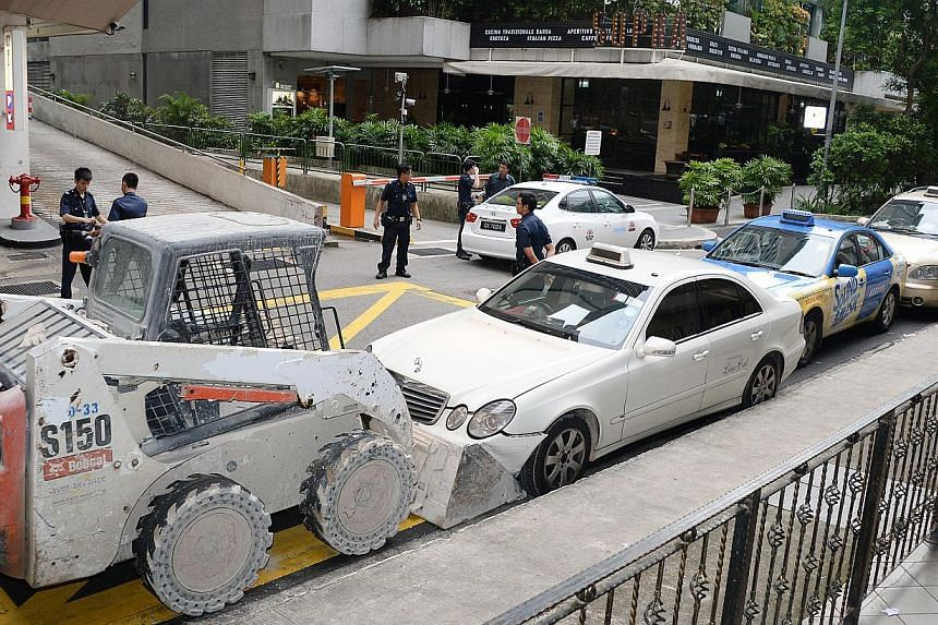 After taking a tractor from a work site near Orchard Road, the man, believed to have been drunk, crashed into a bus stop before driving to Claymore Road, where he hit a taxi. He then rammed into a row of three others along Claymore Drive.