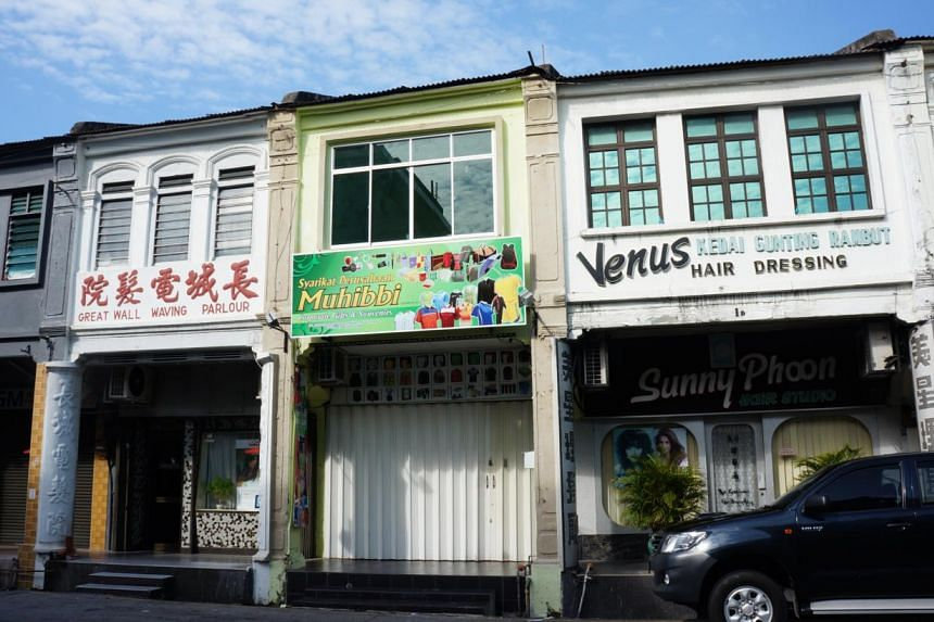A hair salon named 'Great Wall Waving Parlour' is nestled among this row of old-fashioned shops alongCampbell Street in George Town. -- PHOTO: CAROLYN HONG