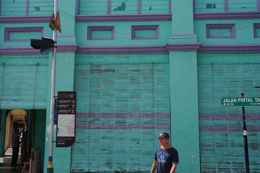 """The beauty of George Town lies in its very nature of being understated, faded and real; a """"living museum"""" where real people do the things that they do best, whether it be making rattan furniture or stainless steel items.-- PHOTO: CAROLYN HONG&n"""