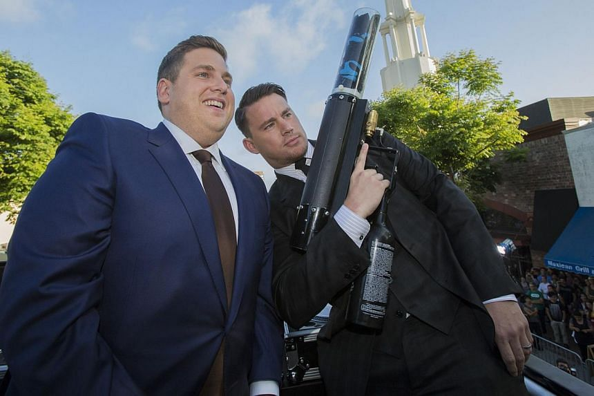 "Cast members Channing Tatum (right) and Jonah Hill pose at the premiere of ""22 Jump Street"" in Los Angeles, California on June 10, 2014. -- PHOTO: REUTERS"