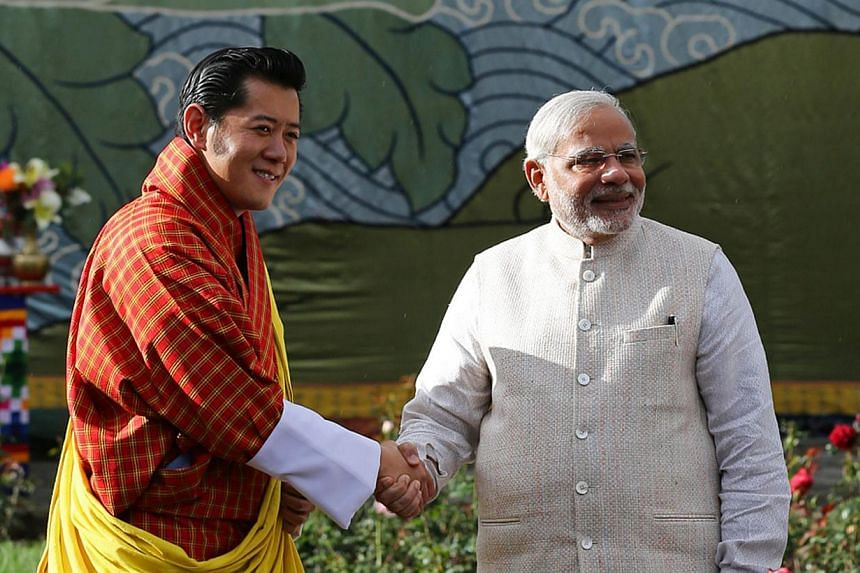 In this handout photograph released by the Royal Office of Media Bhutan, Indian Prime Minister Narendra Modi (right) shakes hands with Bhutanese King Jigme Khesar Namgyel Wangchuck in Thimphu on June 15, 2014. India's Narendra Modi received a grand w