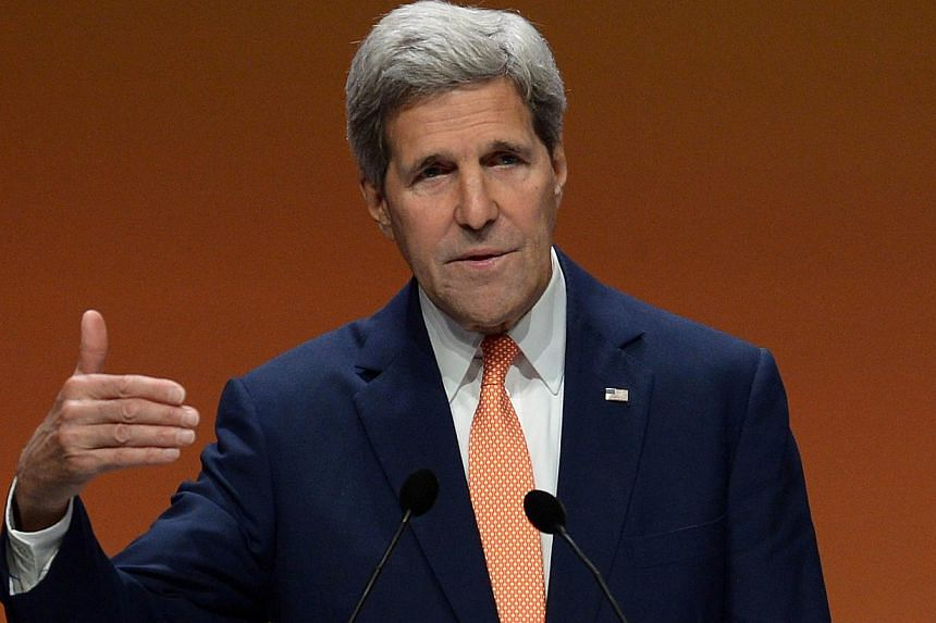 US Secretary of State John Kerry speaks during a press conference at the end of the Global Summit to End Sexual Violence in Conflict in London on June 13, 2014.The United States is considering US air strikes to help the Iraqi government fend of