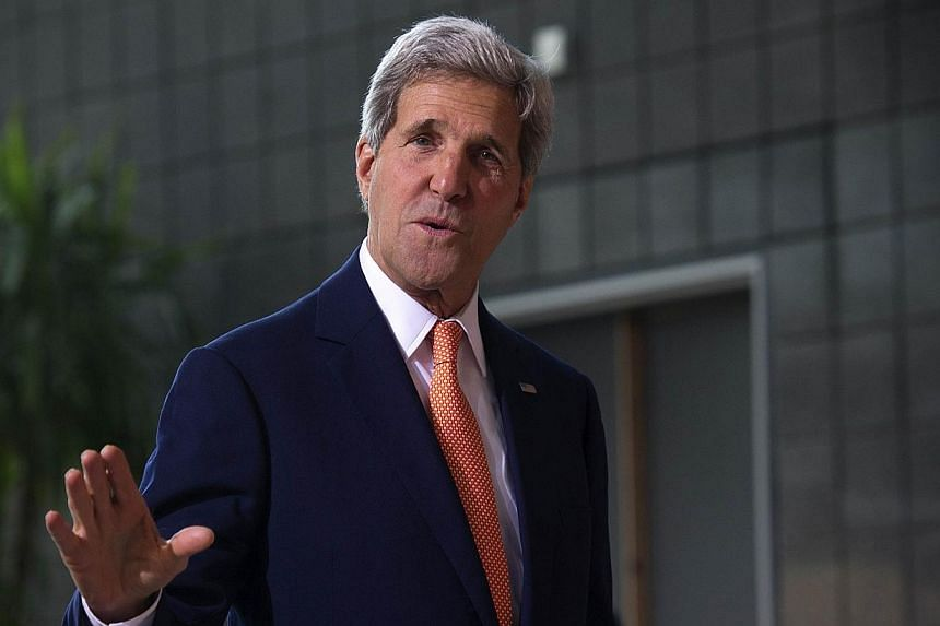 US Secretary of State John Kerry arrives for the Global Summit to End Sexual Violence in Conflict in London on June 13, 2014. US Secretary of State John Kerry Monday called for a global strategy to save the world's oceans, saying everyone had a