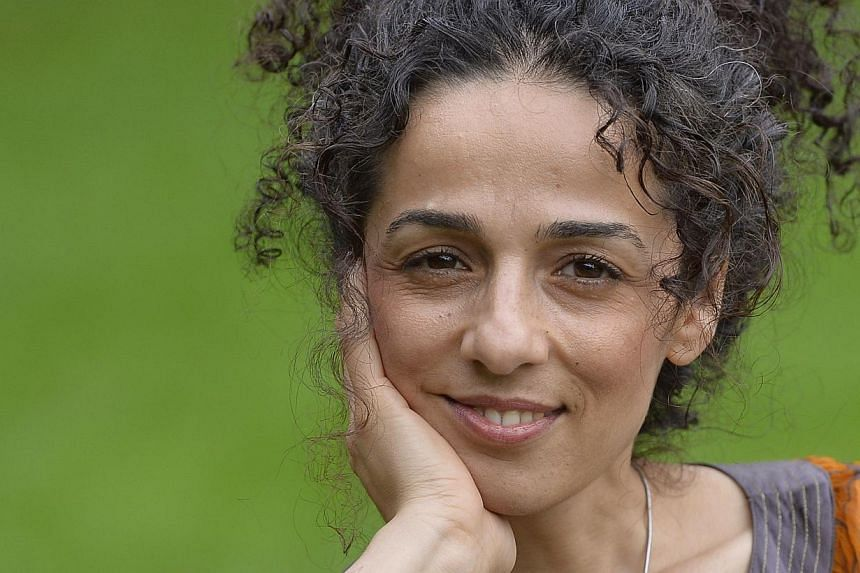 Masih Alinejad, 37, a Britain-based Iranian journalist, poses for a portrait in London in this Oct 8, 2013, file photo. When Ms Masih Alinejad posted a picture of herself online jumping in the air in a sunny, tree-lined London street, the journa
