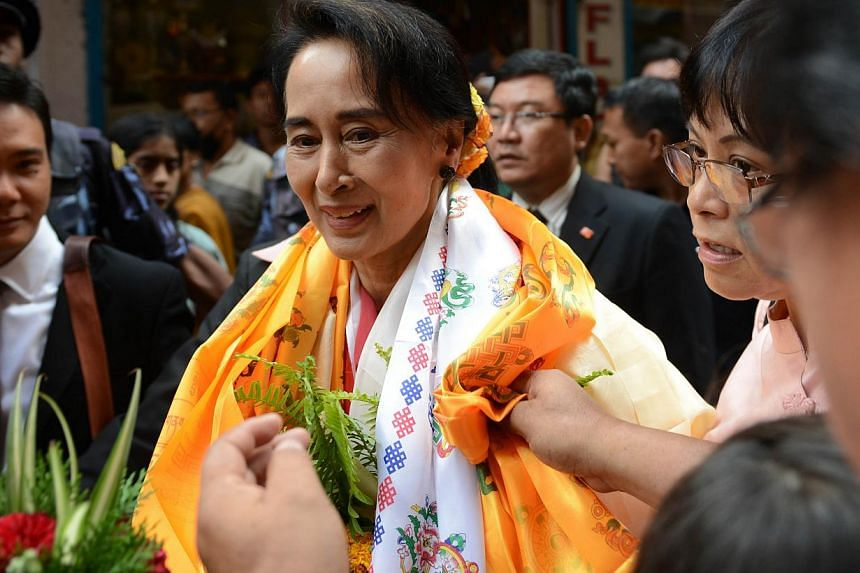 Myanmar opposition leader Aung San Suu Kyi is welcomed at a Buddhist monastery where she worked as an English teacher in 1973 in Kathmandu on June 16, 2014. Myanmar opposition leader Aung San Suu Kyi on Monday accused her country's election comm