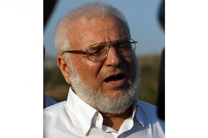 A file picture taken on Jan 19, 2012, shows then Hamas speaker of the Palestinian parliament Aziz Dweik talking to reporters after he was released from Israeli prison, at the Beit Sira roadblock in the West Bank.Israeli troops arrested Palestin