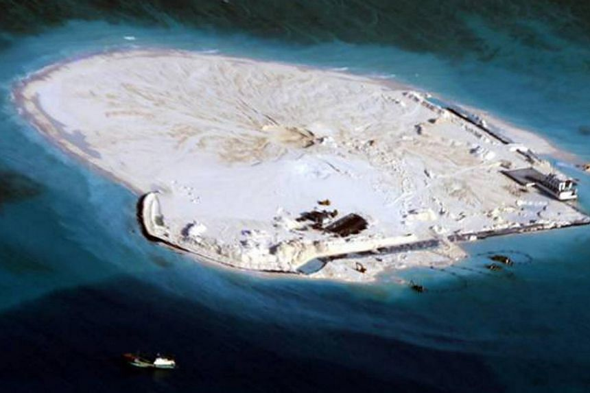 A view of Johnson South Reef, known to China as Chigua Reef and which the Philippines calls Mabini Reef, in the South China Sea in this handout photograph taken on March 11, 2014, by the Armed Forces of the Philippines and released by the Department