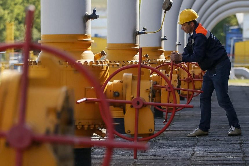 A worker turns a valve at an underground gas storage facility near Striy in western Ukraine in this May 21, 2014, file photo. Russia warned Europe on Monday of possible supply disruptions if Ukraine siphons off gas destined for the West, as it s