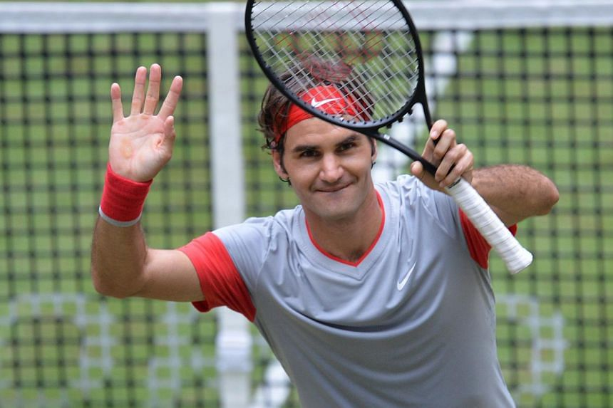 Swiss tennis player Roger Federer celebrates winning his final match against Alejandro Falla from Columbia at the ATP Gerry Weber Open tennis tournament in Halle, western Germany on June 15, 2014. -- PHOTO: AFP