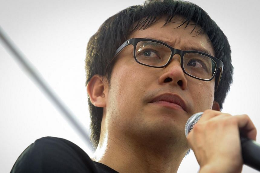 """Blogger Roy Ngerng at the protest called """"Return Our CPF!"""" at Hong Lim Park on June 7, 2014. -- ST PHOTO: ONG WEE JIN"""