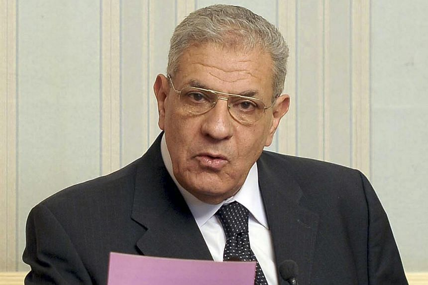Egypt's Prime Minister Ibrahim Mehleb talks during a news conference at the presidential palace in Cairo, in this March 2, 2014 file picture. -- PHOTO: REUTERS