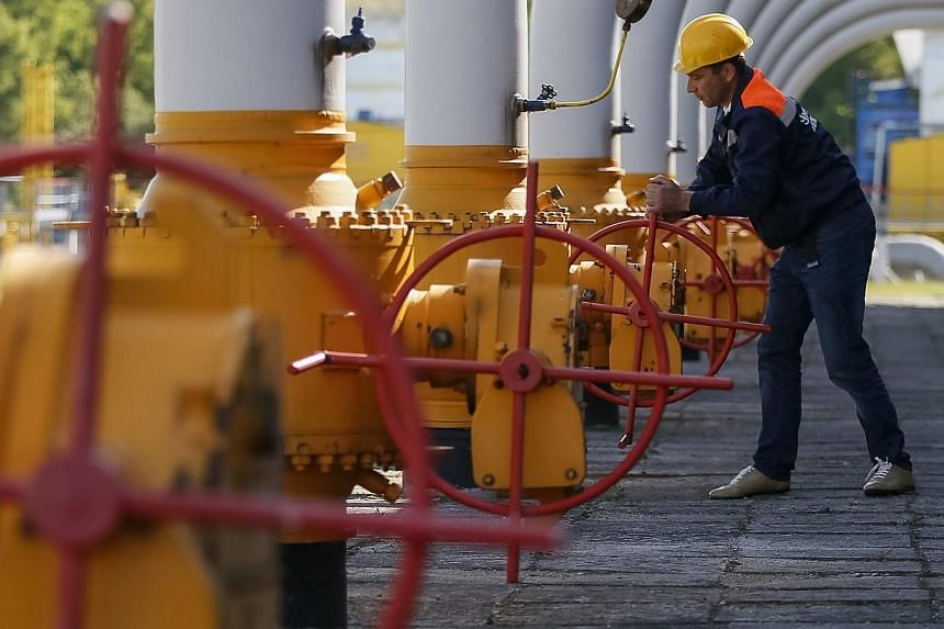 A worker turns a valve at an underground gas storage facility near Striy in western Ukraine on May 21, 2014.A blast hit a major Ukrainian pipeline on Thursday used to transport Russian natural gas to European clients, Ukrainian police officials