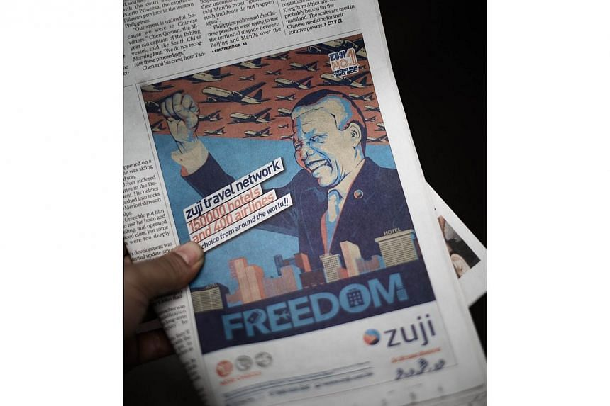 This photo illustration shows a front-page newspaper advertisement featuring an image of Nelson Mandela in Hong Kong on June 17, 2014. -- PHOTO: AFP/PHILIPPE LOPEZ