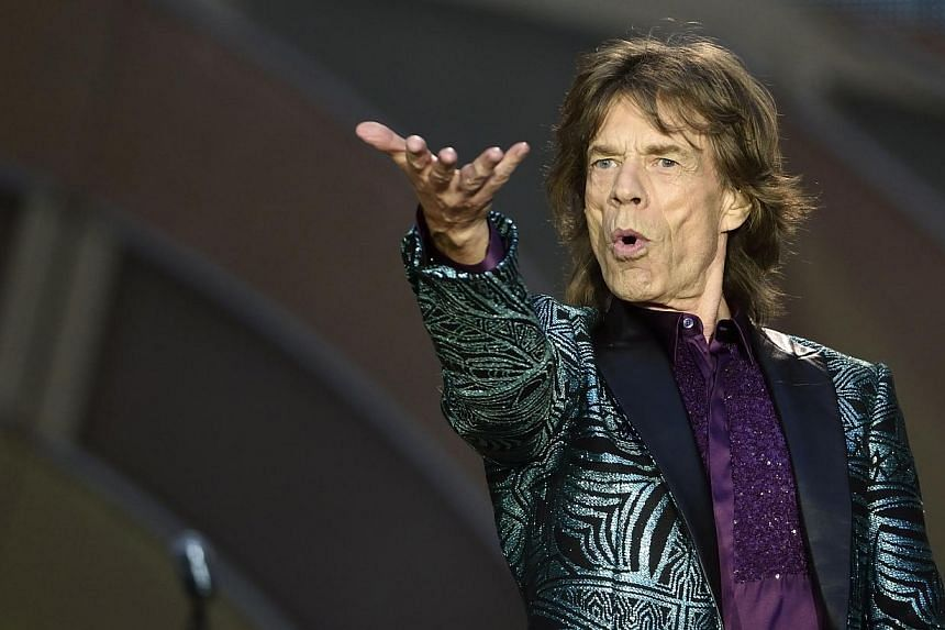 Mick Jagger of the British rock band the Rolling Stones performs during a concert at the Stade de France in Saint-Denis, outside Paris, on June 13, 2014. -- PHOTO: AFP
