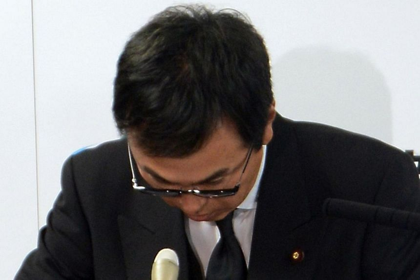 Japanese Environment Minister Nobuteru Ishihara bows his head as he apologies after appearing to suggest people in nuclear disaster-hit Fukushima could be persuaded to put up with contaminated waste if the government threw cash at them, at his office