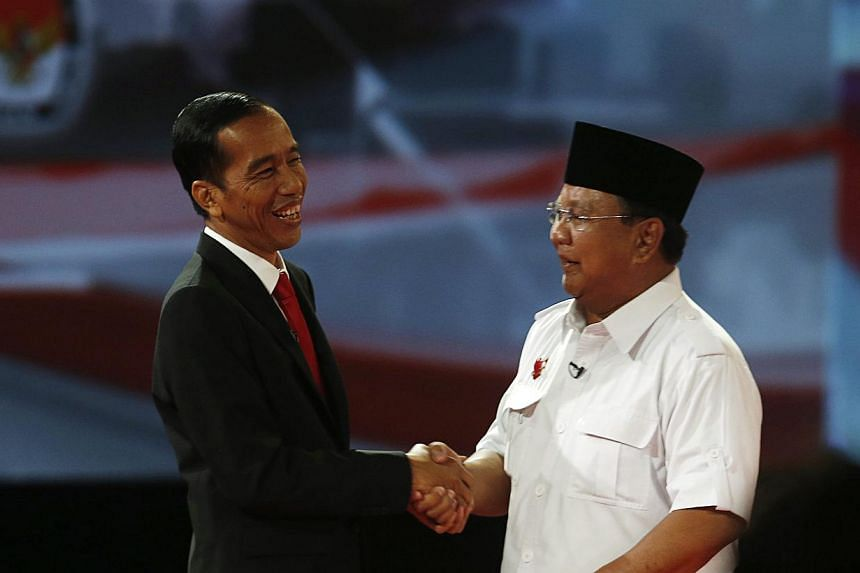 Indonesian presidential candidates Joko Widodo (left) and Prabowo Subianto after Sunday's presidential debate. The latter came out with all guns blazing on Sunday in a complete turnaround.
