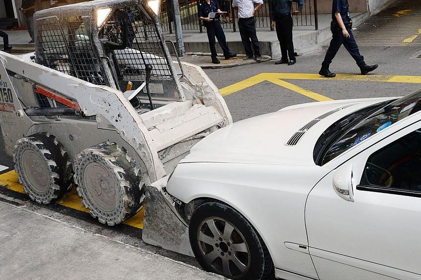 On Sunday, a man took a skid loader from a worksite and went on a drunken rampage, damaging a bus stop and four taxis. -- PHOTO: SHIN MIN DAILY NEWS