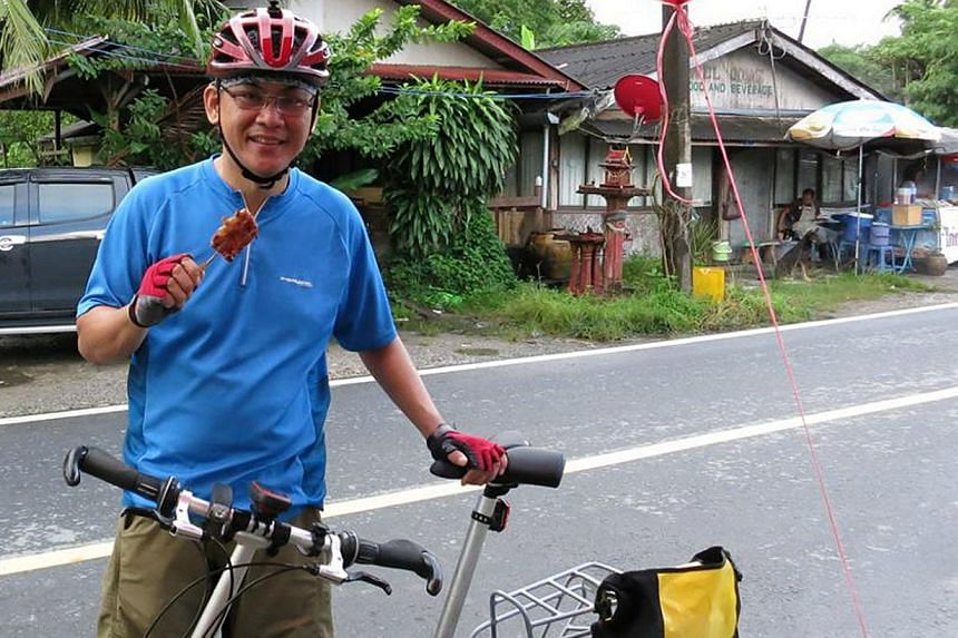 Mr Arthur Yap, 48, an avid cyclist, died on Sunday morning in Malaysia after he was hit by a bus while cycling near a theme park. -- PHOTO: ARTHUR YAP'S FACEBOOK