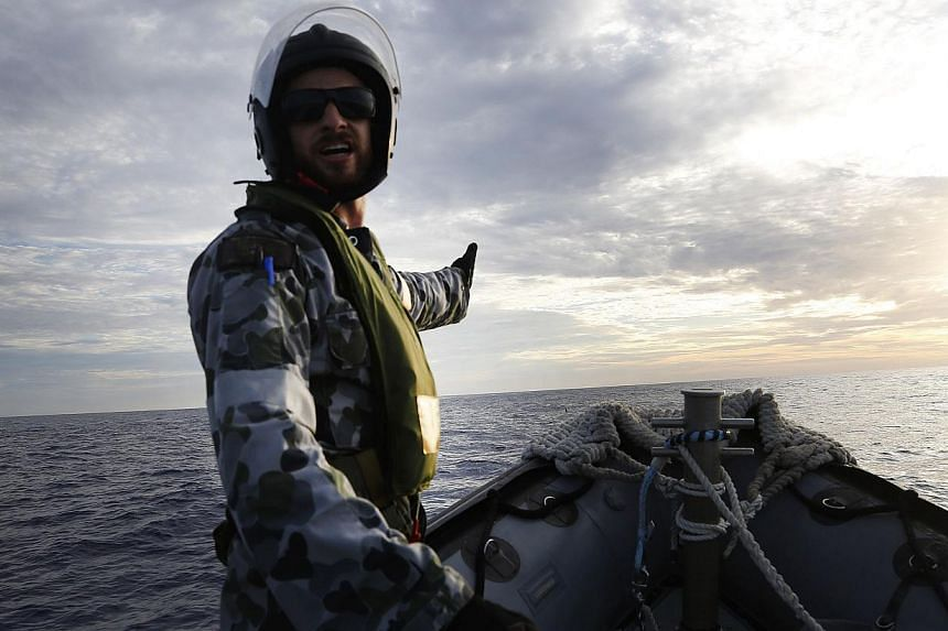 A Rigid Hull Inflatable Boat (RHIB) of HMAS Perth searching for debris from missing Malaysia Airlines flight MH370 in the southern Indian Ocean. -- PHOTO: AFP