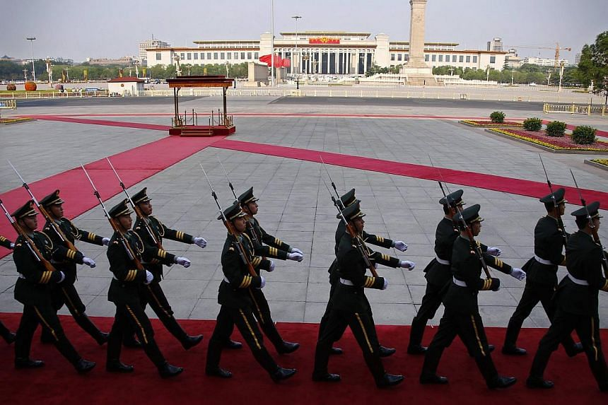 Soldiers from the honour guards of the Chinese People's Liberation Army (PLA) march in front of the Monument to the People's Heroes at Tiananmen Square in Beijing, on June 3, 2014. -- PHOTO: REUTERS