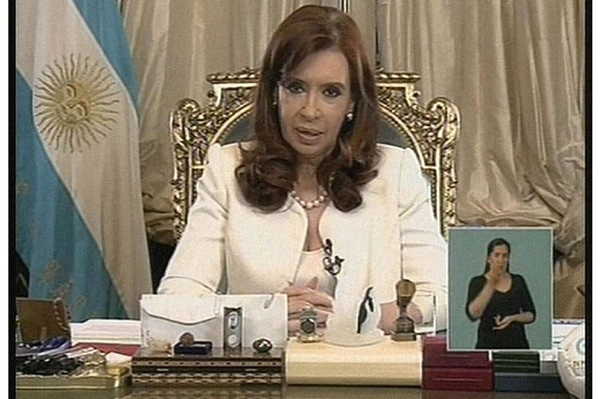 TV grab released by Noticias Argentinas showing Argentine President Cristina Fernandez de Kirchner addressing the nation, in Buenos Aires on June 16, 2014 just hours after the US Supreme Court turned back Argentina's appeals against paying at least $