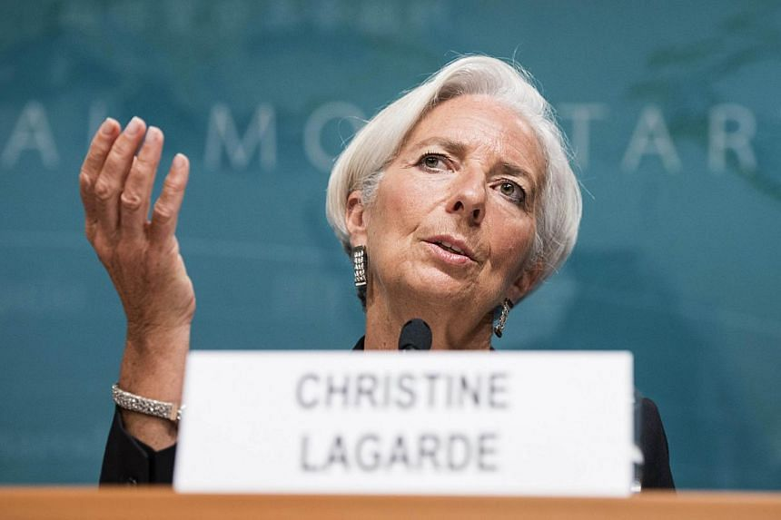 IMF Managing Director Christine Lagarde speaks at the International Monetary Fund's headquarters on June 16, 2014 in Washington, DC. -- PHOTO: AFP
