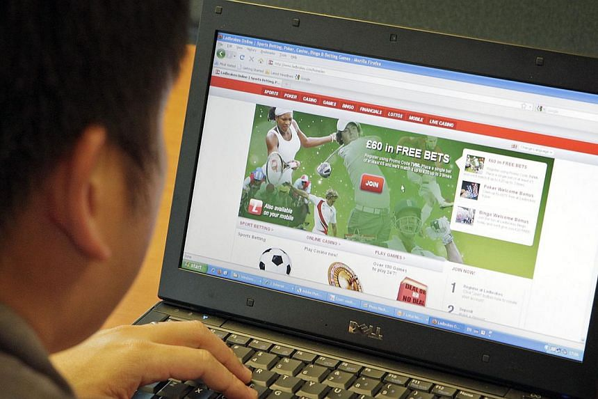 Posed photo of a man looking at an online sports betting site. -- PHOTO: ST FILE