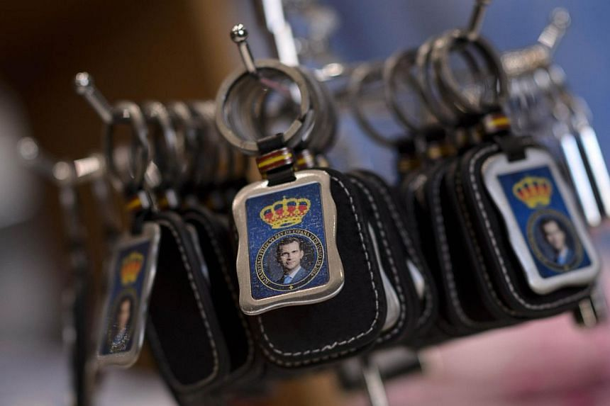 A picture taken on June 14, 2014 shows a key ring with a portrait of Spain's king-in-waiting, Prince Felipe, at a souvenir shop in Madrid. -- PHOTO: AFP