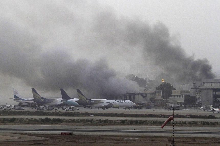 Smoke billows from Jinnah International Airport in Karachi in this June 9, 2014. -- PHOTO: REUTERS