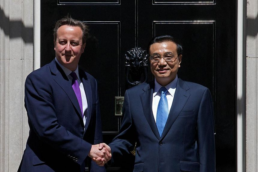 British Prime Minister David Cameron (left) shaking hands with Chinese Premier Li Keqiang outside No. 10 Downing Street ahead of a meeting in London on June 17, 2014. Mr Li met Mr Cameron for talks at his Downing Street office, aimed at boosting econ