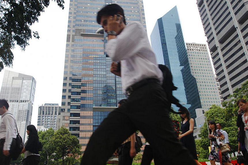 A survey of 5,670 Singapore workers found that nearly half - 46 per cent - do not like their jobs, while three-quarters see their job as nothing more than a way to put food on the table. -- PHOTO: ST FILE