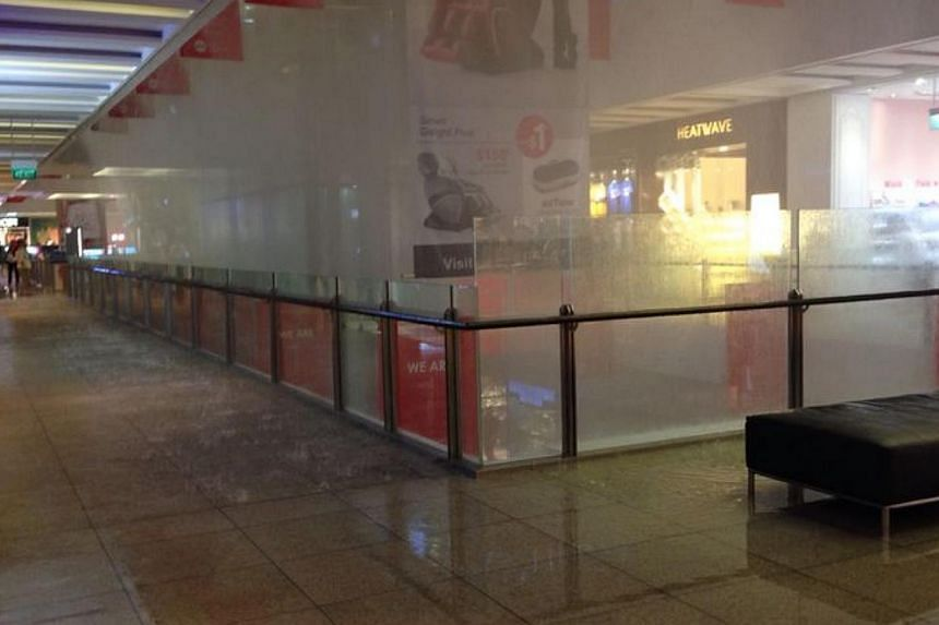 Sprinklers that unexpectedly went off at the JEM mall on Tuesday afternoon damaged goods and forced some tenants to shutter for the day to clean up.--PHOTO: COURTESY OF MAY CHUA