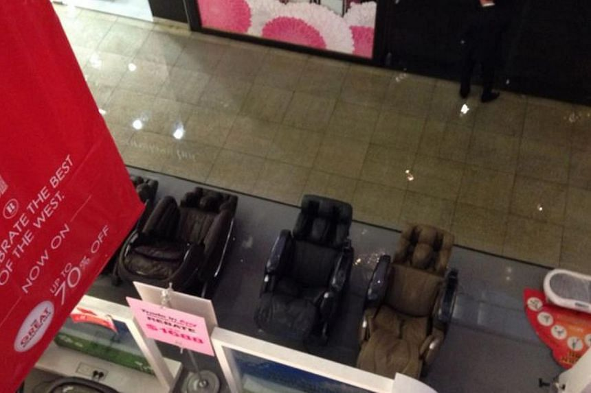 Sprinklers in JEM shopping mall triggered this afternoon, resulting in water cascading down inside the building.--PHOTO: COURTESY OF MAY CHUA